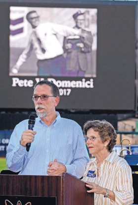 ?? JIM THOMPSON/JOURNAL ?? With an image of longtime U.S. Sen. Pete Domenici behind them, Pete Domenici Jr. and his mother, Nancy Domenici, thank those who came to Saturday's memorial service for the late senator at Isotopes Park.