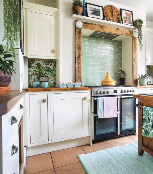 """??  ?? A DURABLE, recycled plastic outdoor rug from Cuckooland picks up the soft green of the kitchen wall tiles and breaks up the floor. """"We treated ourselves to underfloor heating in here, as part of the major kitchen refit,"""" says Antonia. """"It's such a luxury!"""""""