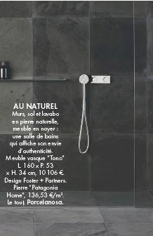 """??  ?? AU NATUREL Murs, sol et lavabo en pierre naturelle, meuble en noyer : une salle de bains qui affiche son envie d'authenticité. Meuble vasque """"Tono"""" L. 160 x P. 53 x H. 34 cm, 10 106 €. Design Foster + Partners. Pierre """"Patagonia Home"""", 136,53 €/m2. Le tout, Porcelanosa."""