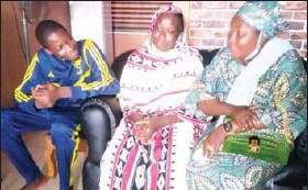 ??  ?? •Chairman of Oriade Local Council Development Area of Lagos State Alhaja Ramotalai Akinlola-hassan (right) consoling Taofikat and Moses, widow and son of the late APC/NURTW chief Kayode Samuel, who was killed last Thursday at a rally in Oriade.