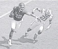 ??  ?? Running back Matt Forte, left, had 29 touches for the Bears on Sunday, gaining 141 yards on the ground and 25 through the air.