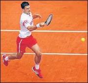 ?? USA TODAY SPORTS ?? Novak Djokovic returns against Lorenzo Musetti.
