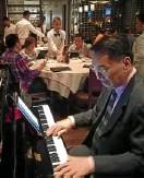 ?? —POCHOLO CONCEPCION ?? Carding Cruz on piano at Wolfgang's Steakhouse, RWM