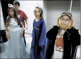 """?? MARK WEBER / THE COMMERCIAL APPEAL ?? Walt Price, 12, makes a funny face through his crown while fellow drama campers Chloe Biggs, 11, (left) and Elena Schauwecker, 12, try on their costumes with the help of director Debbie Vaughn as they prepare for their performance of """"The Emperor's New..."""