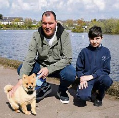 ?? Picture: Denis Minihane ?? Thomas and Callum O'Flynn, Commons Road, Cork, and Cookie the dog, at the Lough, Cork.