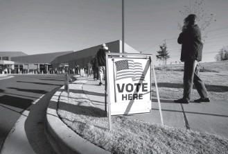 ?? KEVIN D. LILES FOR THE WASHINGTON POST ?? People in Kennesaw, Ga., line up to vote in Senate runoff elections in December. The For the People Act making its way through Congress is aimed at curtailing state-level moves that could impede voting.