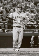 ?? Tony Gutierrez / Associated Press ?? Los Angeles' Mike Trout says he definitely feels the pressure of earning the first playoff victory of his touted career but is more focused on ending the Angels' six-year playoff drought this season.