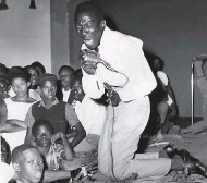 ??  ?? Roy Shirley goes down on his knees as he wowed the audience at the Palace Theatre back in the 1960s.