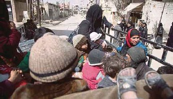 ?? AFP PIC ?? Syrians sitting in the back of a truck, driven by White Helmets, as they flee their homes in Hammuriyeh in Syria's besieged eastern Ghouta on Sunday.