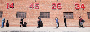 ?? PHOTO: REUTERS ?? All lined up . . . Voters wait to cast their ballots in a queue wrapping around Fenway Park on the first day of early voting in Boston, Massachusetts,yesterday.