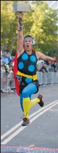 ?? PICTURE: REUTERS ?? Jacob Boyer lifts his Thor hammer while crossing the finish line during the Avengers Super Heroes Half Marathon in California.