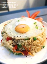 ??  ?? Onlyeg prepared sunny side-up on a plate of fried rice