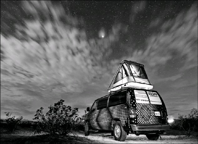 ?? Alex Mauz ?? With the addition of an optional rooftop tent, four people can sleep comfortably in the artist-painted Escape Campervans. They come with a queen-size bed, bedding and basic kitchen and camping gear.