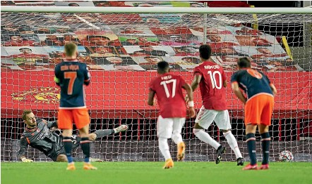 ?? AP ?? Marcus Rashford scores from the penalty spot in Manchester United's 4-1 Champions League group H win over Istanbul Basaksehir at Old Trafford yesterday.