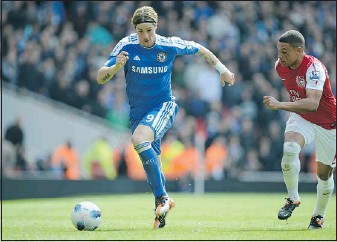 ?? — GETTY FILES ?? Chelsea forward Fernando Torres (left), pictured here in Premier League action against Arsenal, faces his former club Liverpool in the FA Cup final Saturday.