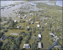 ?? AP PHOTO/DAVID J. PHILLIP ?? Homes are flooded in the aftermath of Hurricane Ida, Monday, Aug. 30, 2021, in Lafitte, La. The weather died down shortly before dawn.