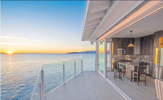 ?? LANDUS DEVELOPMENT GROUP INC. ?? The deck of the show home at SookePoint Ocean Cottage Resort offers stunning views of sea, sky and wildlife.