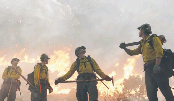 """?? Sony Pictures ?? Sparks fly in a scene from """"Only the Brave,"""" which dramatizes the tragic, true story of Arizona's Granite Mountain Hotshots."""
