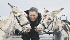 ??  ?? Guy Smith and his donkeys.