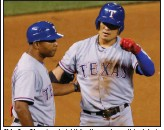 ?? (AP file photo) ?? Shin-Soo Choo (center) hit for the cycle on this date in 2015 for the Texas Rangers against the Colorado Rockies at Coors Field in Denver.