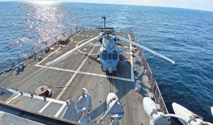 ?? KIM HJELMGAARD/USA TODAY ?? The USS Farragut patrols the Persian Gulf in 2019, part of the huge military presence the United States maintains around the world. Some analysts question the justification and effectiveness of the operations.