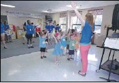 """??  ?? The 4-year- old VBS group and their counselors at Our Lady of Perpetual Help Church learn the song """"Full of Grace"""" along with the movements. The station was led by OLPH senior high youth minister Stephanie Schweitzer."""