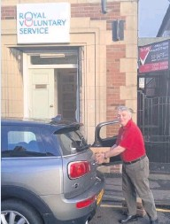??  ?? Out and about Royal Voluntary Service volunteer Charles Harley loading hampers for local delivery