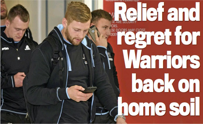??  ?? Calling in: (from left) Hogg Russell and Weir on their phones after landing back at Glasgow Airport yesterday