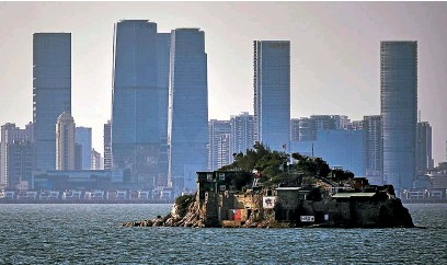 ?? GETTY IMAGES ?? Lieyu, an island within Taiwan's territory, is less than 5km from the Chinese city of Xiamen, which can be seen in the background. Taiwan's future security presents the US and its allies with a conundrum.