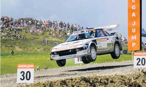 ?? PHOTO: GEOFF RIDDER ?? Flying high . . . Mosgiel driver Chris Hey and his codriver Koby Hey are airborne in their Toyota MR220 at the Battle of Jacks Ridge event in Auckland last weekend.