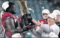 ?? THE ASSOCIATED PRESS ?? Alabama coach Nick Saban and offensive lineman Alex Leatherwood celebrate the Crimson's Tide's sixth national title under Saban, whowon the first of his career at LSU in 2003.