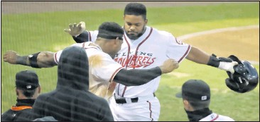 ?? ALEXA WELCH EDLUND/TIMES-DISPATCH ?? Heliot Ramos was met by Squirrels teammate Andres Angulo after hitting a home run at The Diamond on Wednesday. The powerful Ramos, ranked among the top prospects in the Giants' system, could quickly hit his way out of Double-A.