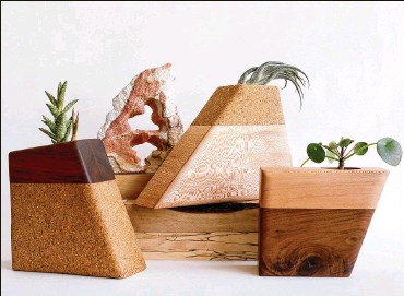 """??  ?? C.C. Boyce creates """"Planturns,"""" custom-made wood urns for cremation remains, in her studio in the garment district in Los Angeles. Left: Walnut top and cork bottom. Center: Cork top and sycamore bottom. Right: Sycamore top and walnut bottom."""