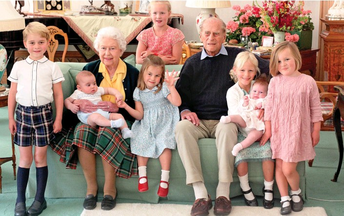 ??  ?? Happy family: The Queen and Prince Philip at Balmoral in 2018 with, from left, George and Louis, Charlotte, Savannah Phillips, Isla Phillips, Lena and Mia Tindall