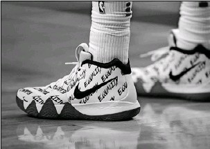 ?? Charles Krupa/The Associated Press ?? The word equality also adorned shoes worn by Boston Celtics guard Kyrie Irving during a game Jan. 16 in Boston.