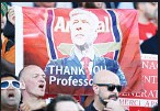 ??  ?? Arsenal fans cheer for outgoing manager Arsene Wenger in the stands after the English Premier League soccer match between Arsenal and Huddersfield Town, at the John Smith's Stadium, in Huddersfield, England on May 13. (AP)