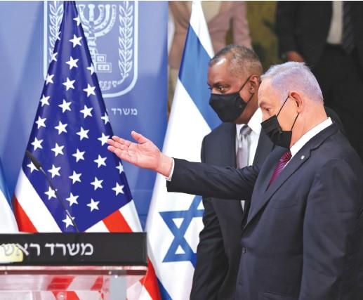 ??  ?? US DEFENSE SECRETARY Lloyd Austin and Prime Minister Benjamin Netanyahu arrive to give a statement after their meeting in Jerusalem on Monday. (Menahem Kahana/Reuters)