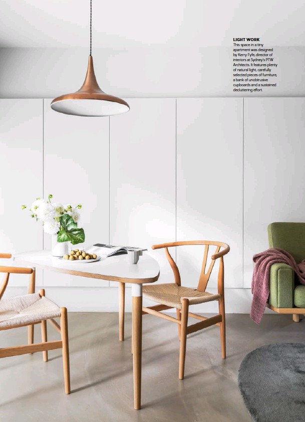 ??  ?? LIGHT WORK This space in a tiny apartment was designed by Kerry Fyfe, director of interiors at Sydney's PTW Architects. It features plenty of natural light, carefully selected pieces of furniture, a bank of unobtrusive cupboards and a sustained decluttering effort.