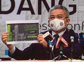 ?? (Foto BERNAMA) ?? Dr Adham pada sidang media khas di Putrajaya, semalam.