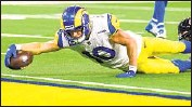 ?? Wally Skalij Los Angeles Times ?? COOPER KUPP comes up short of the end zone on this dive, but did score on a long pass in the opener.