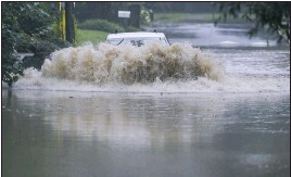 ?? BRYNN ANDERSON ?? A car attempts to drive through flood waters near Peachtree Creek near Atlanta, as Tropical Storm Fred makes its way through north and central Georgia on Tuesday, Aug. 17, 2021. (AP Photo/Brynn Anderson)