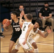 ?? CHRIS SZAGOLA — THE ASSOCIATED PRESS ?? Providence's Alyn Breed, left, slips past Villanova's Justin Moore, right, and Collin Gillespie during the second half Saturday at the Pavilion. The Wildcats stifled Providence and ran out to a 71-56 win.