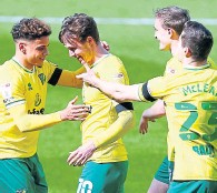 ??  ?? Kieran Dowell (Norwich City) celebrates his goal with team-mates