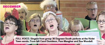 ??  ?? DECEMBER FULL VOICE: Singers from group 36 Degrees South perform at the Violet Town carols. From left Carol Davidson, Pam Meagher and Sue Woodall.