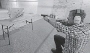 ?? GEORGE FREY/GETTY IMAGES ?? A shooter at a Utah gun range kneels as he aims. Enrolment has spiked for teachers who want to learn how to shoot.