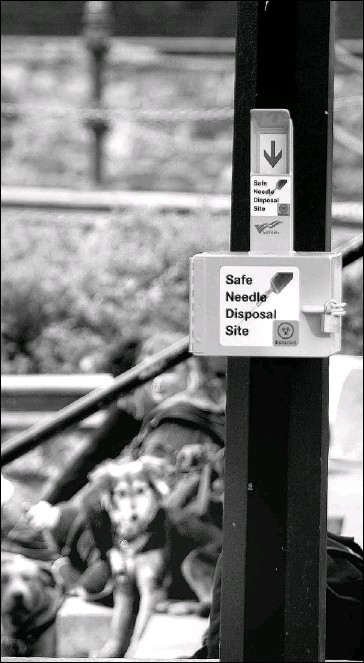 ??  ?? A city sign post at Wharf and Yates near Reeson Park is one of five locations where boxes for used syringes have been installed. Letter-writers say Victoria has gone too far in providing facilities for drug addicts.