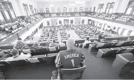 ?? ERIC GAY/AP ?? People sit in the gallery of the Texas House chamber in Austin last month during a debate on Republican-backed voter legislation.