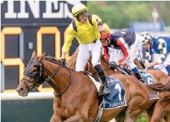 ?? Courtesy: Racing NSW Twitter ?? ↑ Tom Marquand, aboard Addeybb, celebrates after winning the Queen Elizabeth Stakes on Saturday.