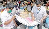 ?? MPOST ?? EVM distribution ahead of the fifth phase of Assembly elections at Bidhannagar College in Kolkata on Friday