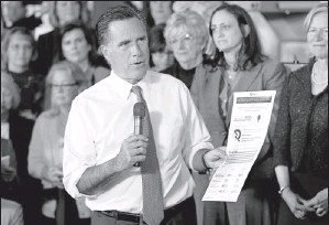 ?? By Steven Senne, AP ?? Candidate says most jobs lost under Obama were women's: Mitt Romney speaks in Hartford, Conn., on Wednesday. He rebuts claims that Republicans are insufficiently supportive of women.